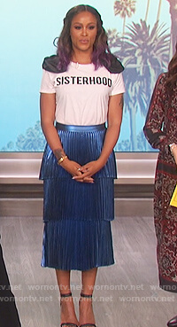 Eve's white sisterhood t-shirt and pleated blue skirt on The Talk