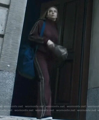 Villanelle's burgundy striped track jacket and pants on Killing Eve