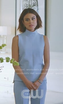 Cristal's blue sleeveless mock-neck top and trousers on Dynasty