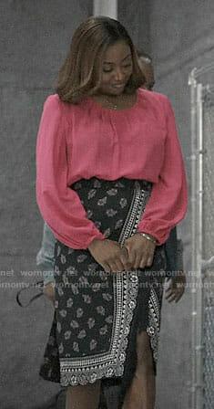 Daisy's pink blouse and printed wrap skirt on Madam Secretary