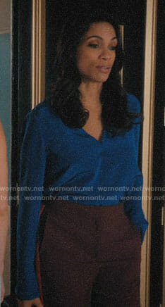 JR's blue blouse and burgundy pants on Jane the Virgin