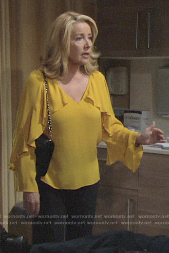 Nikki's yellow ruffled blouse on The Young and the Restless