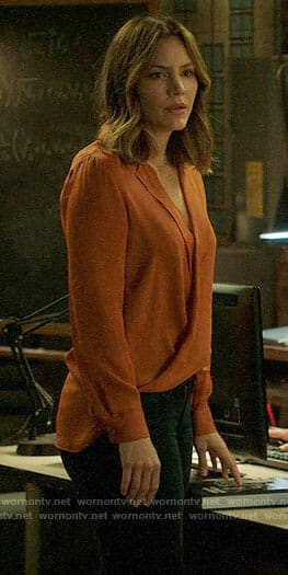 Paige's orange wrap blouse on Scorpion