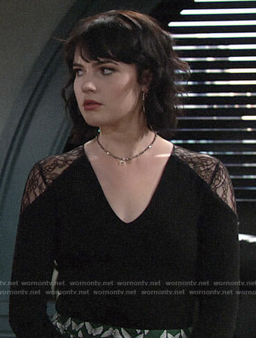 Tessa's lace shoulder top and green butterfly print pants on The Young and the Restless