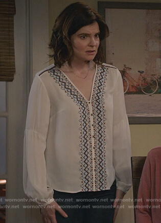 Heather's white v-neck embroidered top on Life in Pieces
