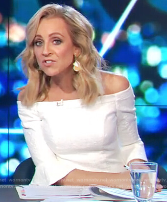 Carrie's white off shoulder dress on The Project