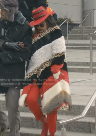 Cookie's striped fur coat and red snake hat on Empire