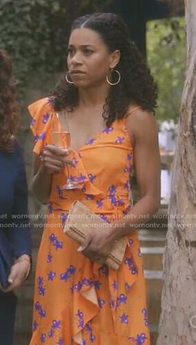 Maggie's orange printed ruffled dress on Grey's Anatomy