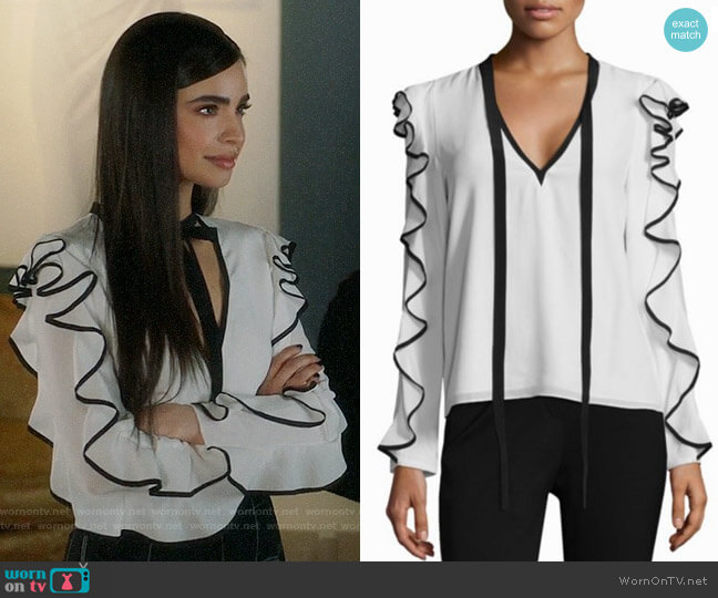 Alexis Darcy Contrast Trim Ruffle Blouse worn by Sloane Silver (Sofia Carson) on Famous in Love