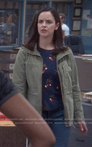 Amy's cherry print sweater and army jacket on Brooklyn Nine-Nine