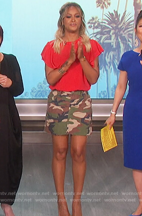 Eve's red ruffle sleeve top and camo print skirt on The Talk