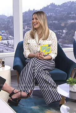 Carissa's white printed blouse and striped pants on E! News Daily Pop