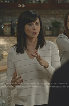 Cassie's white striped v-neck sweater on Good Witch