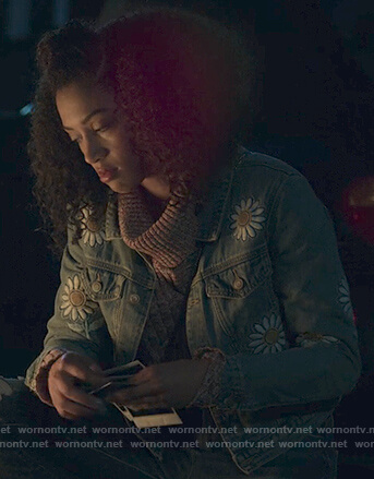 Nina's daisy patch denim jacket on 13 Reasons Why