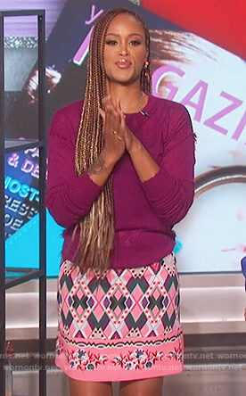 Eve's purple distressed top and printed skirt on The Talk