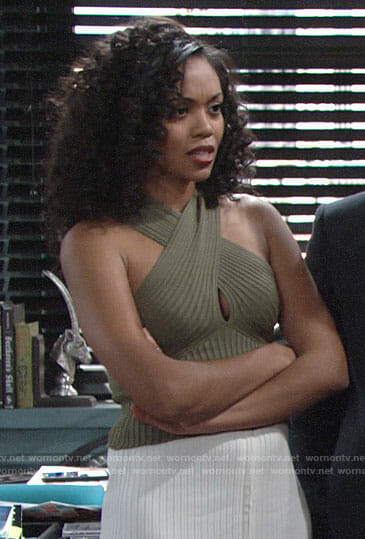 Hilary's green crossover top and white skirt on The Young and the Restless