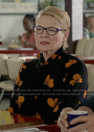 Joan's black and orange floral dress on Life in Pieces