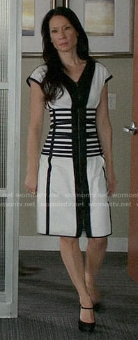 Joan's black and white dress with striped waist on Elementary