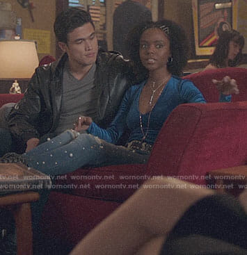 Josie's blue velvet top and pearl embellished jeans on Riverdale