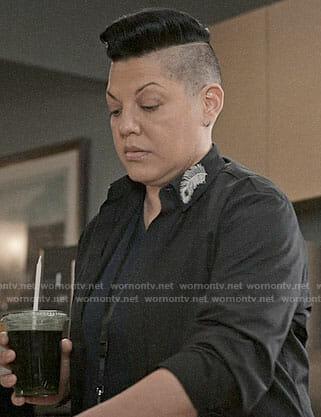 Kat's black shirt with peacock feather collar on Madam Secretary