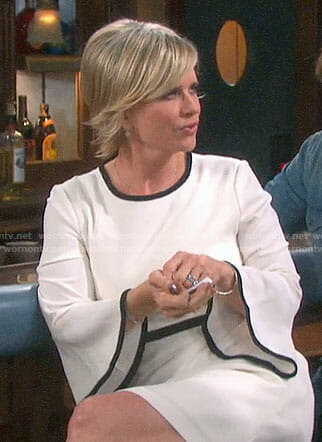 Kayla's white bell-sleeve dress with black trim on Days of our Lives