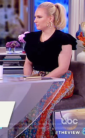 Meghan's black ruffle sleeve top and floral print maxi skirt on The View