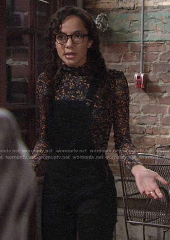 Mattie's floral turtleneck top and black denim overalls on The Young and the Restless