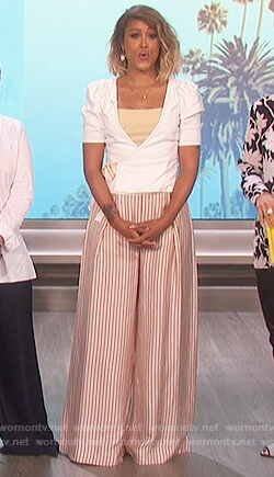 Eve's white puff shoulder top and striped metallic pants on The Talk