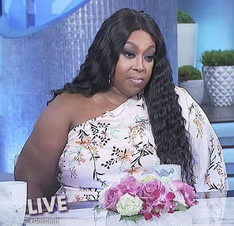 Loni's floral print one shoulder jumpsuit on The Real
