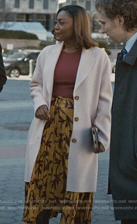 Daisy's pink coat and leaf printed skirt on Madam Secretary
