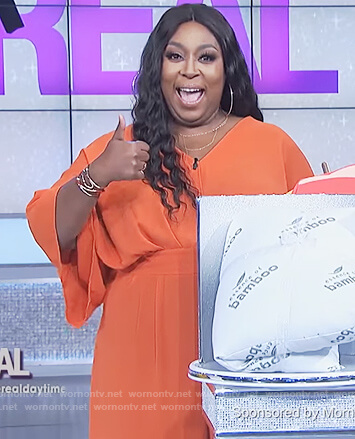 Loni's orange v-neck jumpsuit on The Real