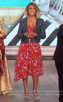 Eve's red floral print dress and leather moto jacket on The Talk