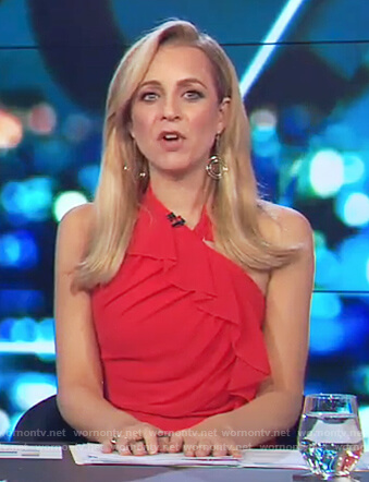 Carrie's red halter neck ruffle dress on The Project