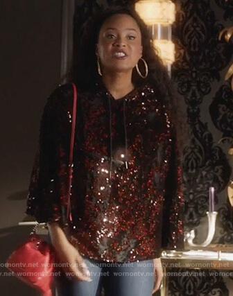 Tangey's red sequin hooded poncho on Famous in Love