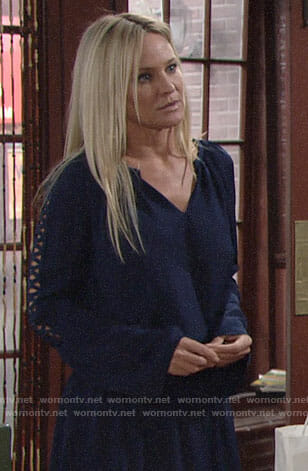 Sharon's navy dress with cutout sleeves on The Young and the Restless