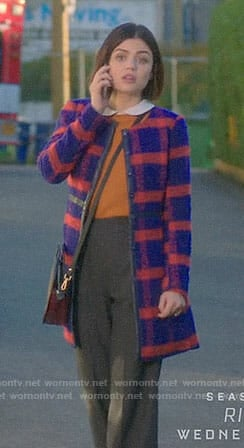 Stella's blue and red checked coat on Life Sentence