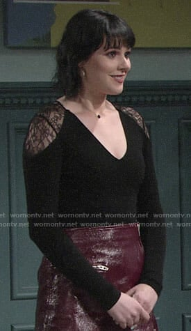 Tessa's black lace-shoulder top and burgundy leather skirt on The Young and the Restless