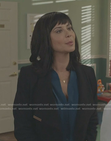 Cassie's blue blouse and black wrap coat on Good Witch