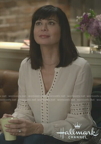 Cassie's white grommet trim blouse on Good Witch