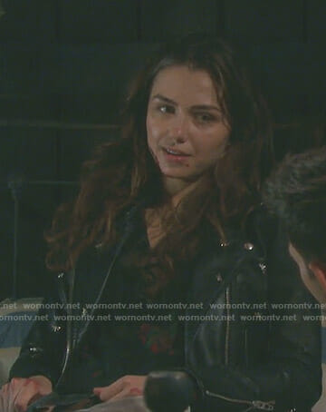 Ciara's black floral print top and dragonfly moto jacket on Days of our Lives