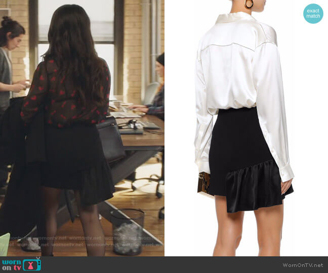 Ruffled satin-paneled crepe mini skirt by Cinq a Sept worn by Katie Stevens on The Bold Type