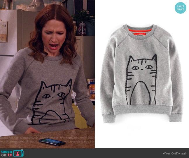 'Elle' Sequin Sweatshirt by Boden worn by Ellie Kemper on Unbreakable Kimmy Schmidt