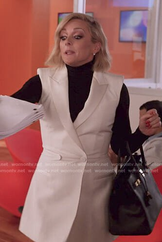 Jacqueline's white sleeveless blazer dress on Unbreakable Kimmy Schmidt