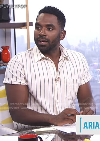 Justin's white striped short sleeve shirt on E! News Daily Pop