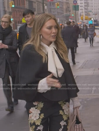 Kelsey's white tie neck blouse and black floral pants on Younger