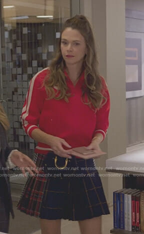 Liza's red track jacket and checked mini skirt on Younger