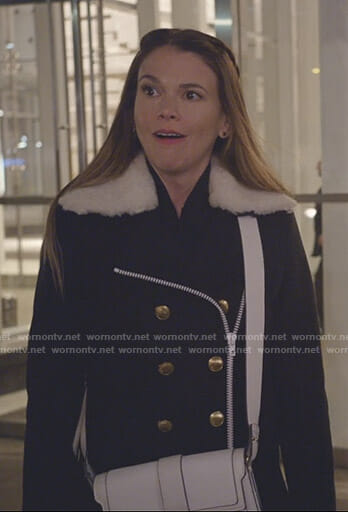 Liza's navy double breasted coat with shearling collar on Younger