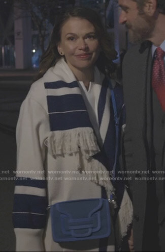 Liza's white and blue striped fringe coat on Younger