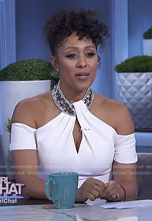 Tamera's white cold-shoulder keyhole dress on The Real