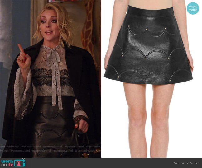 Scalloped Rockstud Leather A-Line Miniskirt by Valentino worn by Jacqueline Voorhees (Jane Krakowski) on Unbreakable Kimmy Schmidt